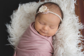 dusty rose baby girl smiling