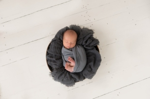 newborn wrapped in nest