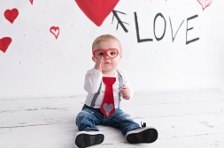 valentines day mini boy in red heart glasses