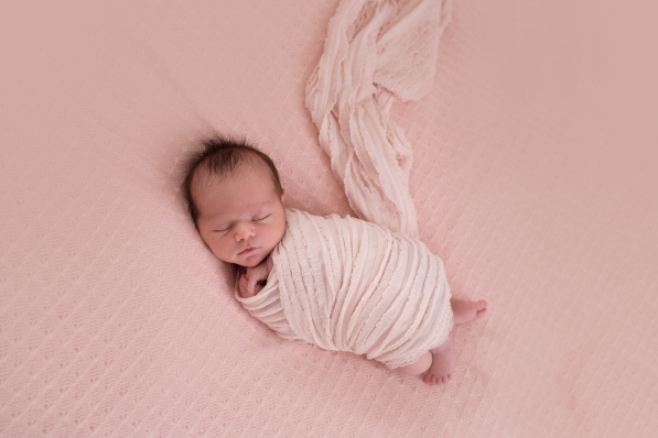 baby in pink wrap