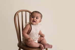 vintage baby sitting in chair