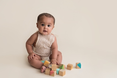 sittter girl playing with blocks