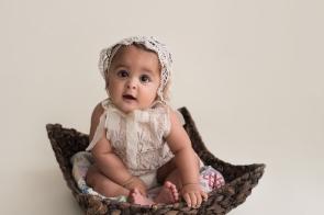 baby girl vintage bonnet in basket