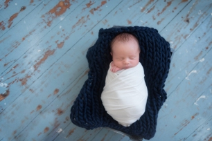 baby wrapped all in blue