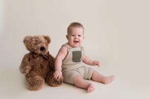 baby boy sitting with bear
