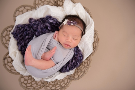 baby girl in basket lavender
