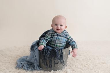 baby boy in a bucket