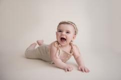 laughing baby girl in vintage romper